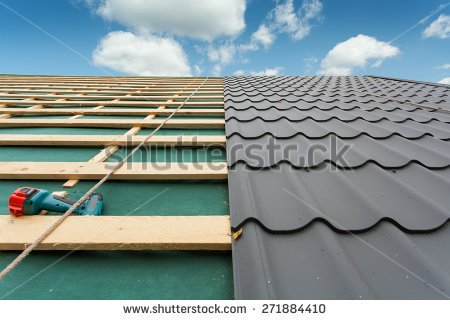 stock-photo-house-under-construction-roof-with-metal-tile-screwdriver-and-roofing-iron-271884410